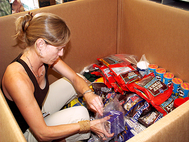 Packing snacks into a box destined for a field camp.