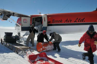 People load cargo onto plane.
