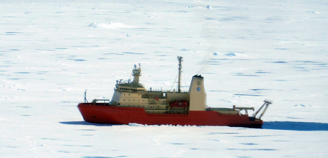 Ship moves through sea ice.