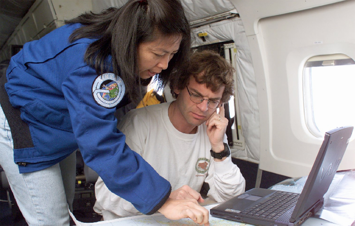 Scientists aboard plane conducting aerial survey.