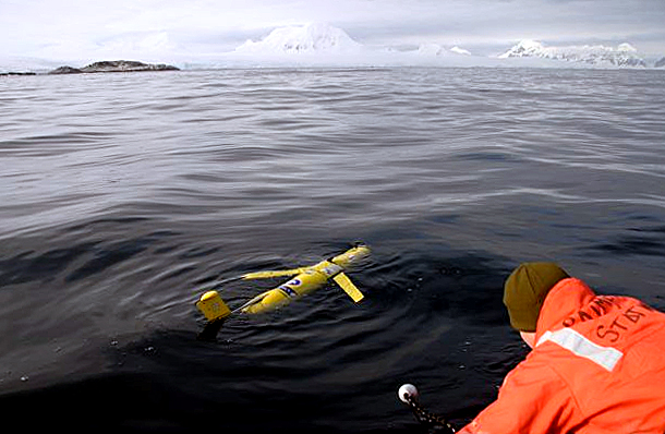 Scientists release instrument into the water.