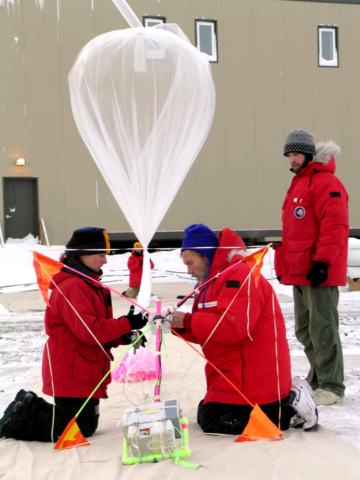Scientists prepare ozone instruments for launch.