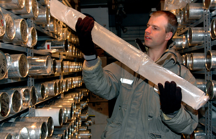 Scientist Paolo Gabrielli examines ice core.