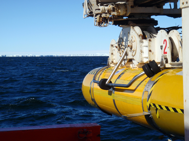 Yellow robot sub and ice shelf in distance.