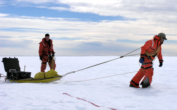 Scientist Ted Scambos hauls a sled.