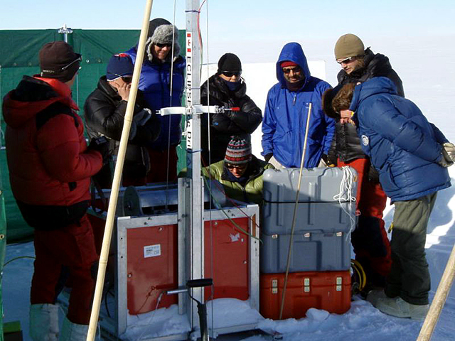 Traverse team attempts to recover stuck drill.