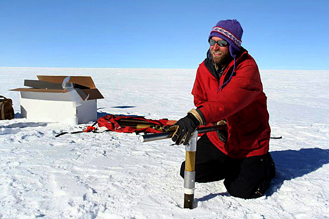 Tom Neumann drills an ice core.
