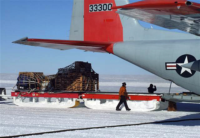 Sleds of cargo unloaded from a plane.