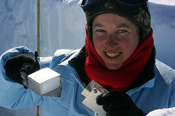 Woman holds up ice sample.
