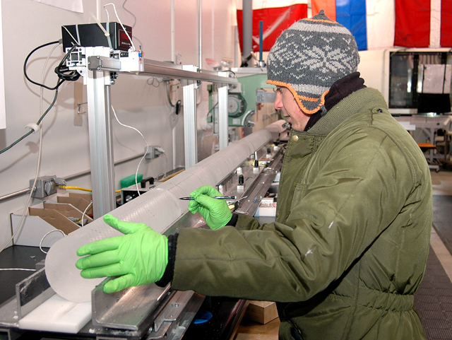 Person prepares ice core.