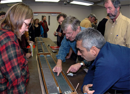 People look at sediment cores.