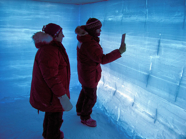 People examine wall of snow pit.
