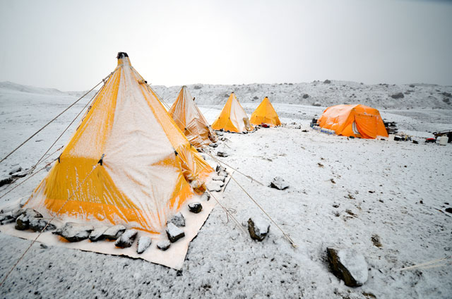 Tents covered in snow.
