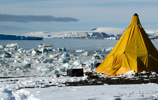 Tent pitched on snow and ice.