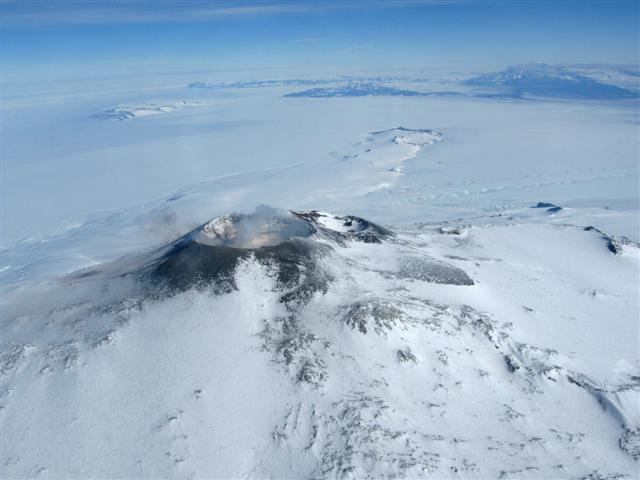Volcano crater amid plain of ice.