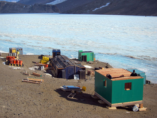 Buildings on the edge of ice-covered lake.