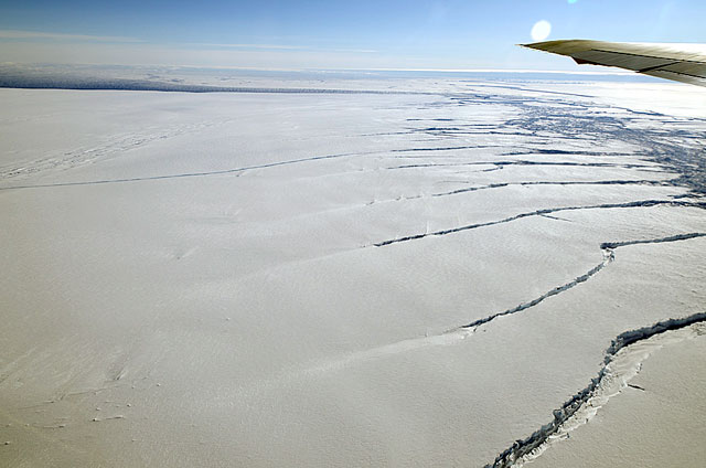 Plane tip seen over expanse of ice.