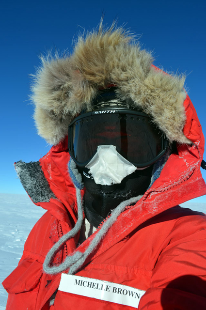 Person wearing parka and goggles.