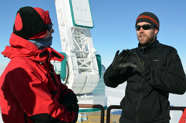 People converse in cold weather gear.