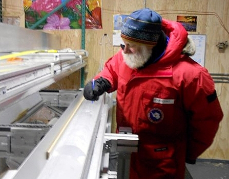 Person examines ice core.