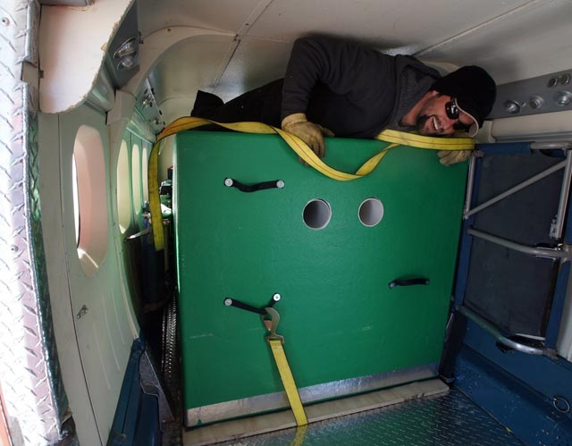 Person climbs over object in plane.