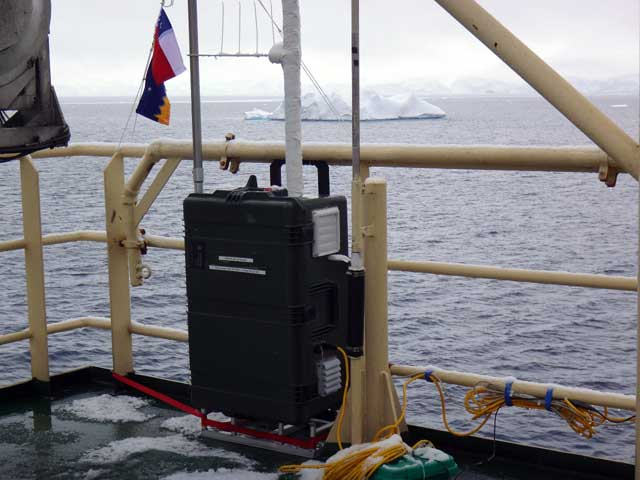 Instrument attached to ship railing.