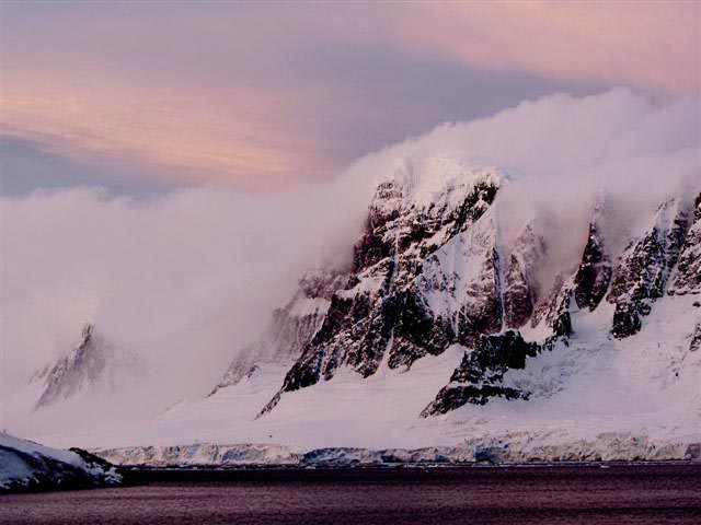 Rugged mountains topped by ice.