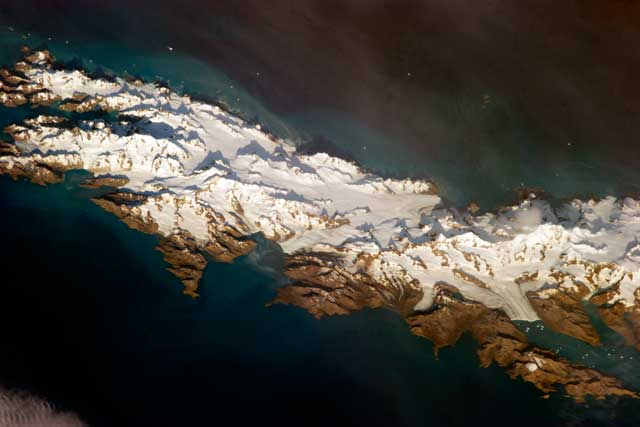 Aerial photo of snow-covered island.
