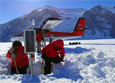 Scientists unbury a seismic station that was buried by snow in the Transantarctic Mountains.