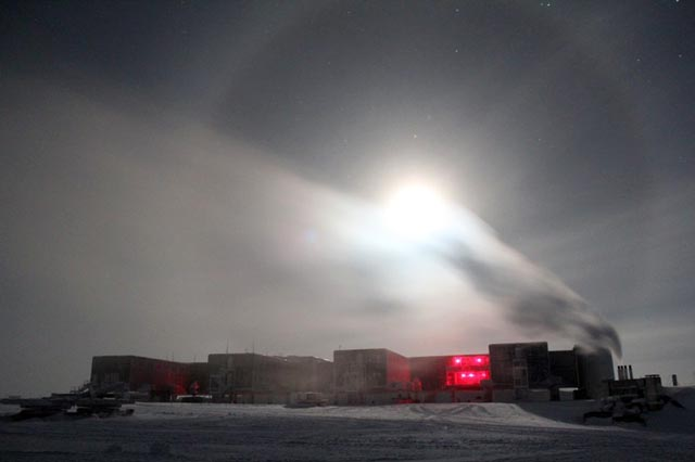 Moon creates halo over a building.