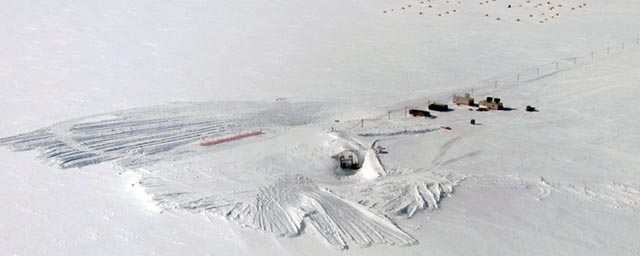 Aerial view of snow and buildings.