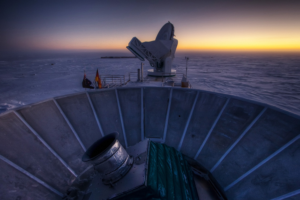 Two telescopes with sunset.