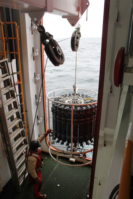 Person operates ocean instrument.