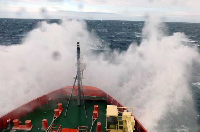 Bow of ship in rough seas.