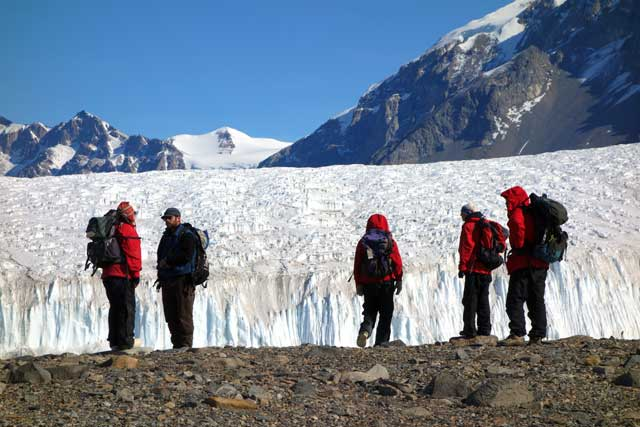 People gather near a glacier.