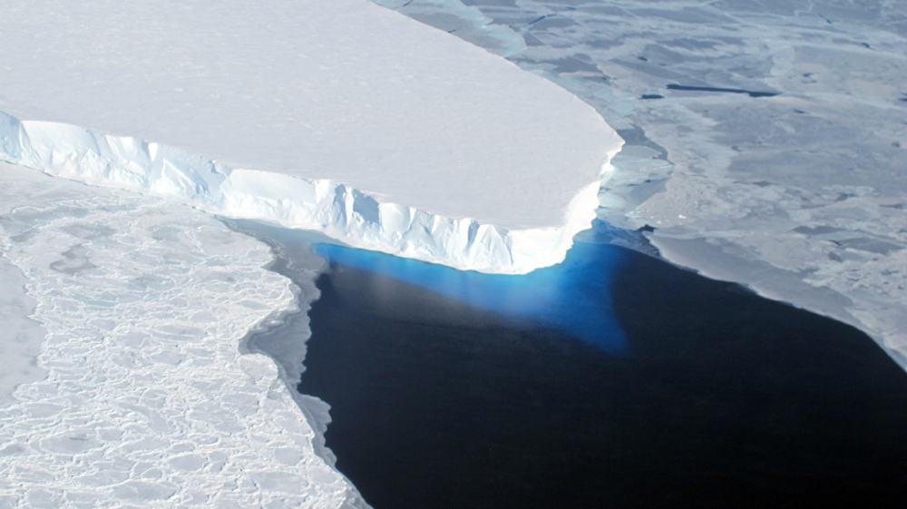 Aerial view of ice shelf and water.