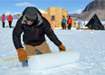 IDDO driller Mike Jayred measures an ice core atop of Taylor Glacier during the 2013-14 summer field season.