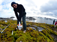Scientist David Beilman cores a moss peatbank near Ukraine's Vernadsky Station with a permafrost corer.