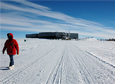 A person walks away from the South Pole Station in 2013.
