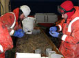 Scientists sort through marine critters captured from the seafloor aboard the research vessel NATHANIEL B. PALMER.