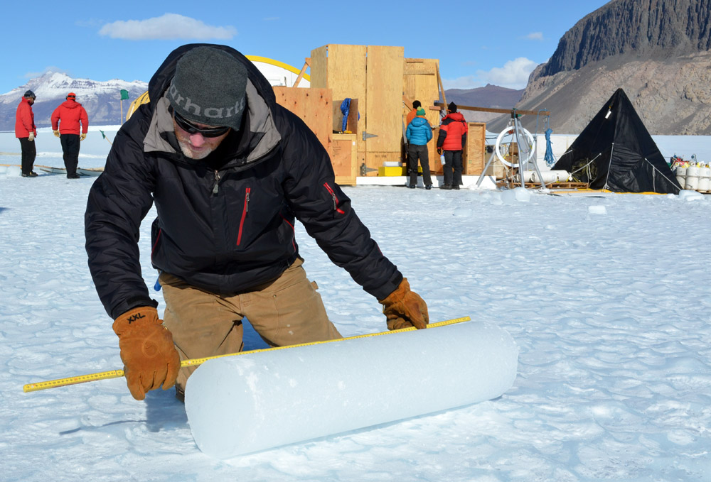 Person measures ice core.