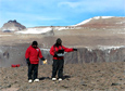 Geologist Mark Salvatore, right, takes spectral measurements in Upper Wright Valley in the McMurdo Dry Valleys, with the help of Mike Wyatt.