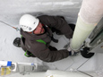 Lead driller Tanner Kuhl guides the Intermediate Depth Drill into position to start ice-coring operations.