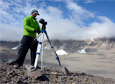 Researcher Joe Levy sets up a digital thermal-imaging camera to study water tracks as they move under the soils of the McMurdo Dry Valleys.