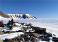 A team of scientists working in the Thomas Hills region of West Antarctica collects rocks that will help map out how the ice in this region melted during previous warm periods in Earth's history.