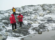 Scientists survey unusual sulfate formations near a small pond by the Lewis Cliff Ice Tongue.