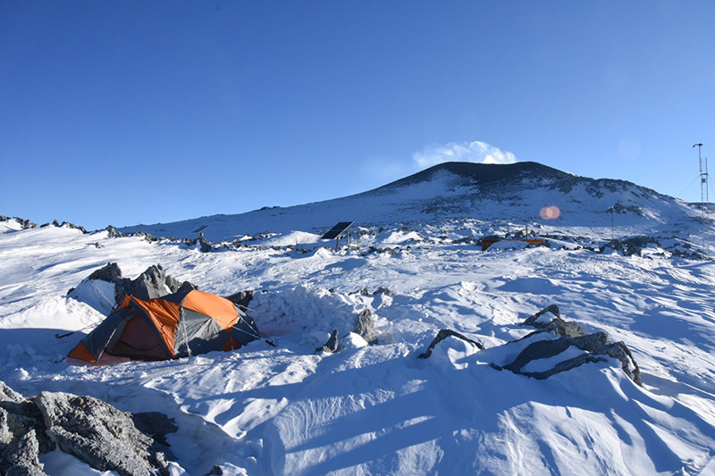 The team camped on the side of Mount Erebus, who's smoking crater can be seen in the background
