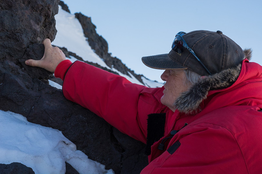 Lisa Tauxe retrieves a chunk of volcanic rock from Cape Armitage on Ross Island