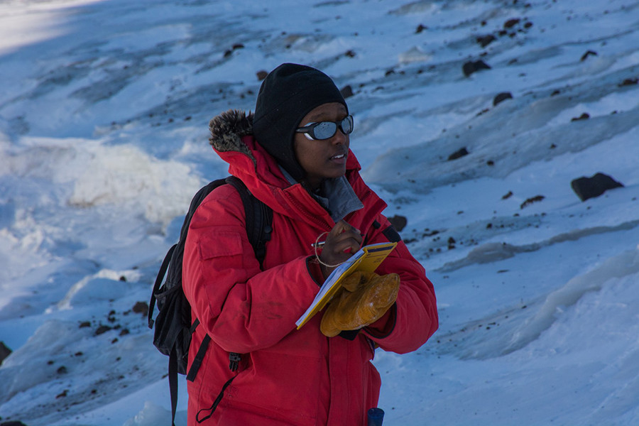 Hanna Asefaw takes down notes about the kinds of rocks they collected and their location