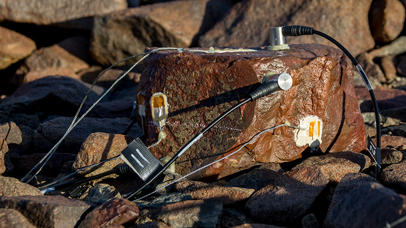 Acoustic emission monitors wired up to the team's rocks listen and record as the stones crack from erosion.